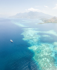 Aerial View of Coral Reef and Pinisi Ship Near Flores