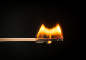 Photo of burning matchstick.