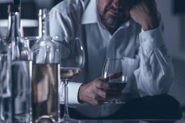 Sad lonely alcoholic drinking wine