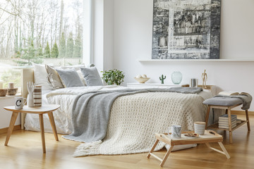 Painting in scandi bedroom interior