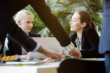 Young businesswomen in office meeting using laptop