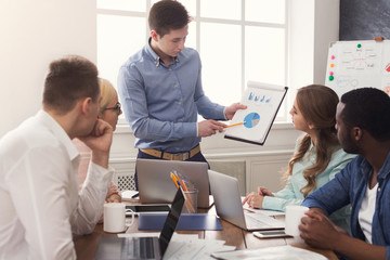Man giving presentation to colleagues in office