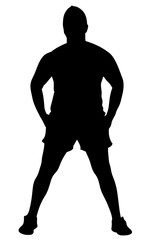 silhouette of a muscular man standing with his hands in his pockets