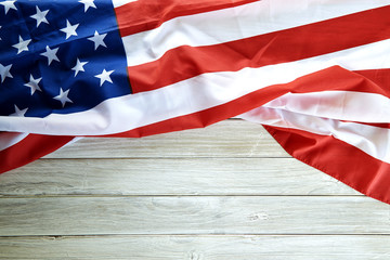 Flag of the USA on wooden background