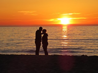 Couple in Love on Sand Beach Seaside during Romantic Sunset