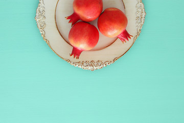 Rosh hashanah (jewish New Year holiday) concept. Pomegranate raditional symbol.