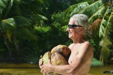 senior man at tropical resort