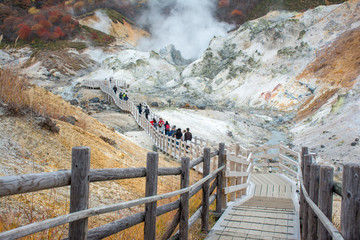 Jigokudani or Hell Valley in the town of Noboribetsu Onsen, hot steam vents, sulfurous streams and other volcanic activity, hot spring waters, Hokkaido, Japan.