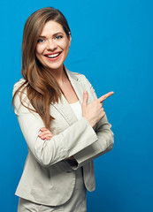 Woman wearing business suit pointing up with finger.