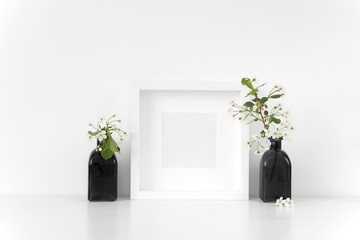 White square frame mock up with spring cherry bouquet. Mock up for your photo, design or text.