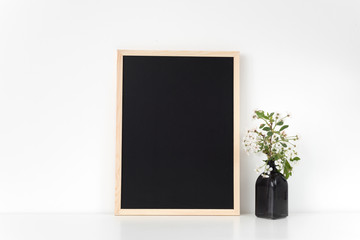 Chalkboard frame mock up with spring cherry bouquet. Mock up for your photo, design or text.