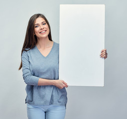 Smiling girl holding white advertising clear board.