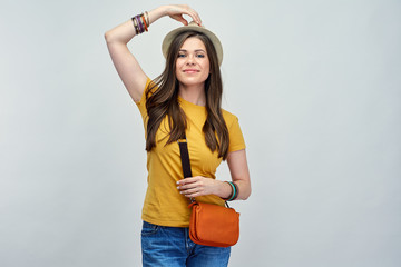 Smiling woman fashion portrait with hat and shoulder bag.