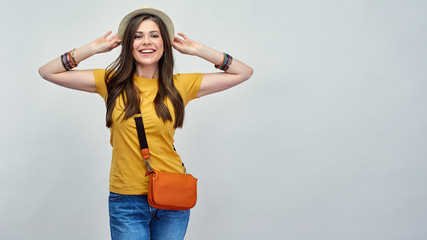 Fashion portrait casual style with woman rasing hands up.