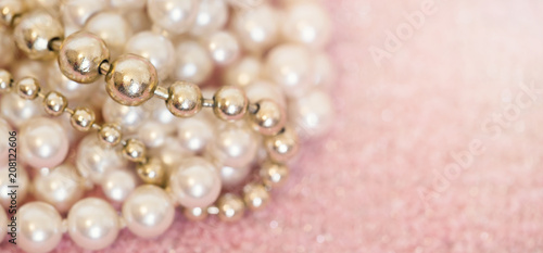 White And Golden Pearls Necklace On Pink Background