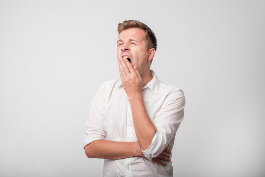 Portrait of caucasian yawning man.