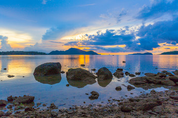scenery sunrise above big rocks in Rawai sea