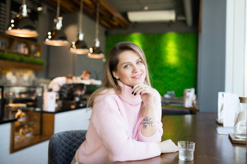 attractive woman in cafe smiling