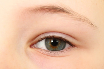 Beautiful eye girl close-up. Background. A child's view.