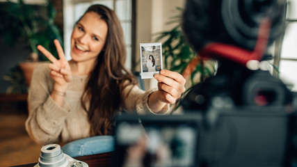 Woman blogger recording her content on camera