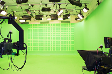 Modern empty green photo studio with modern style movie camera