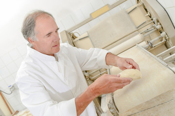 Baker preparing bread