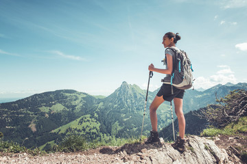 Healthy fit young woman hiker on a mountain summit