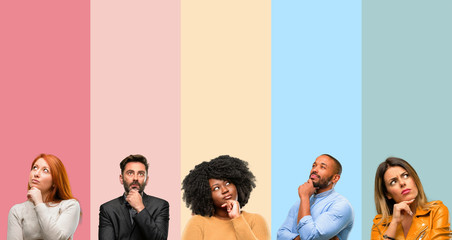 Cool group of people, woman and man thinking and looking up expressing doubt and wonder