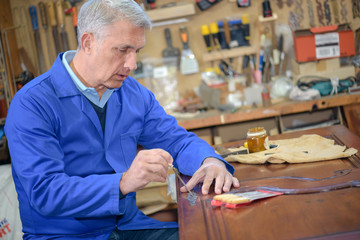 skilled wood worker working with wood
