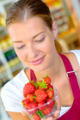 Woman looking at strawberries