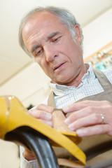 cobbler repairing stilettos