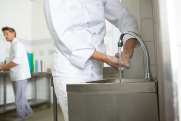 chef hands washing his hands