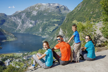 Family with children above Geiranger Fjord.