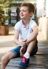 boy sitting ouydoor