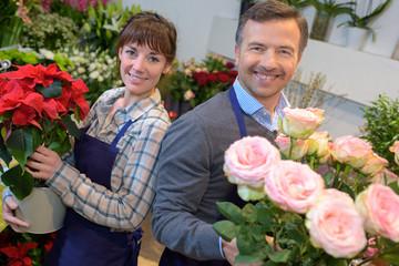 florist holding bouquet of flowers