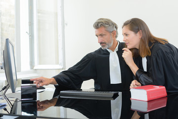 lawyers examining an evidence