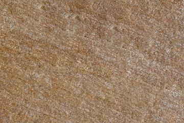 Texture of red untreated stone.