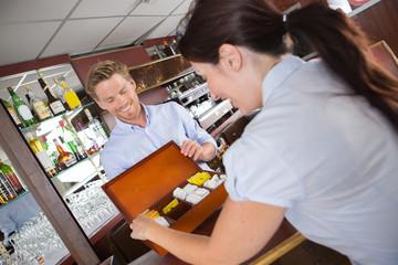 female buyers choosing tea on grocery shelves