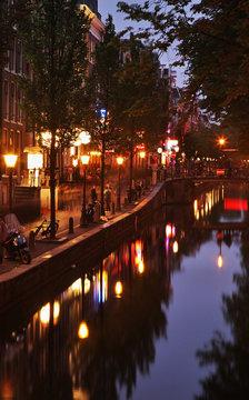 Embankment of canal at De Wallen - Red Light district. Amsterdam. Netherlands