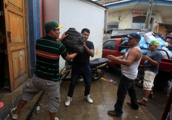 Store owners take their belongings and items after looting during a protest against Nicaraguan President Daniel Ortega's government in Granada