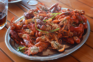 stack of boiled red crayfish on silver plate