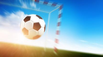 Ball flying into football goal