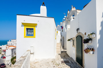 Colorful houses in Peschici, a famous town in Apulia (Southern Italy) for summer holidays