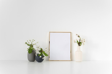 Gold frame mock up with spring cherry bouquets in interior. Mockup for your photo, design or text.