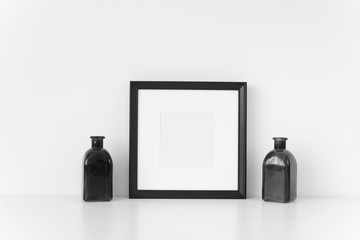 Minimal black square frame mockup . Mock up for your photo, design or text.