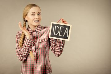 Proud confident woman holding idea sign