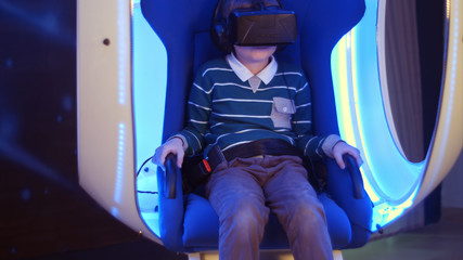 Excited boy enjoying virtual reality attraction