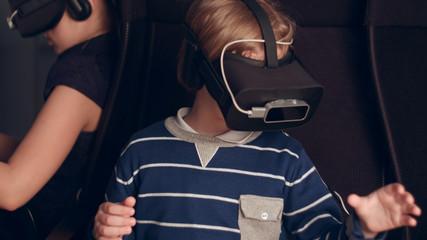 Children enjoying virtual reality attraction