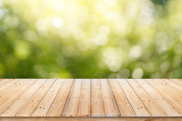 Abstract spring or summer with sunlight background and wood table.