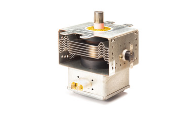 Used magnetron unit from microwave oven on white background